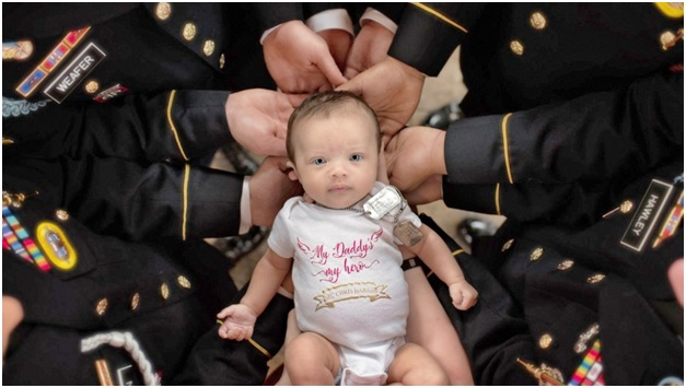 Chris Harris Regiments Soldiers Holding His Baby Christian Michelle Harris
