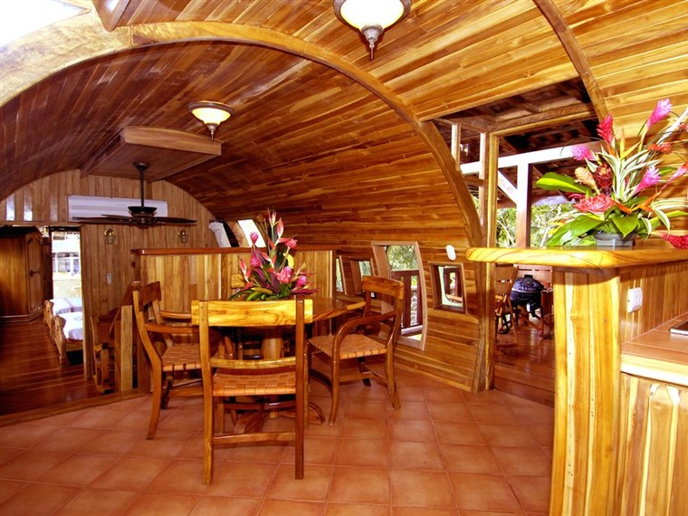 (A Kitchenette with a Dining Area Inside the Boeing 727 Vacation House)