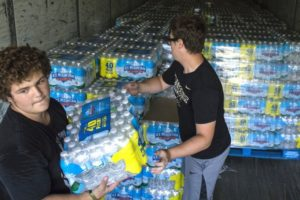 Residents Stocking up Water Bottles to Survive the Impact of Impending Storm